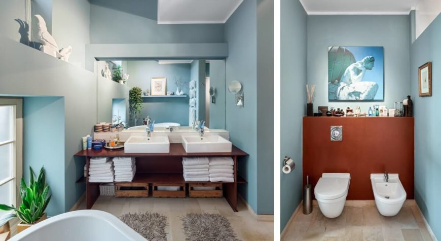 The second bathroom has a very open feel thanks to the high ceilings. You can see the angle from the roof and the use of ledges in the upper spaces of the room allow the lighting and shadowing to play a part in the feel of the room.