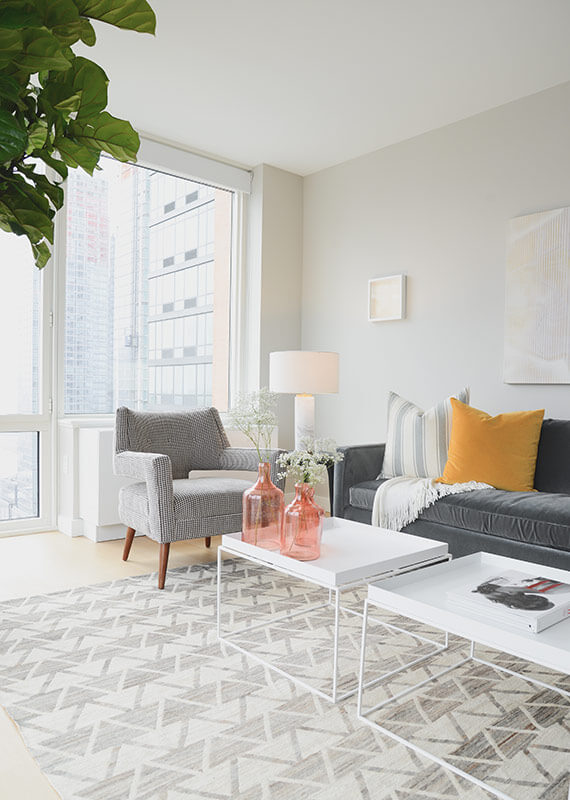 The white wire-frame coffee tables, walls, and window framing all conspire to emphasize the bright and open nature of the interior.