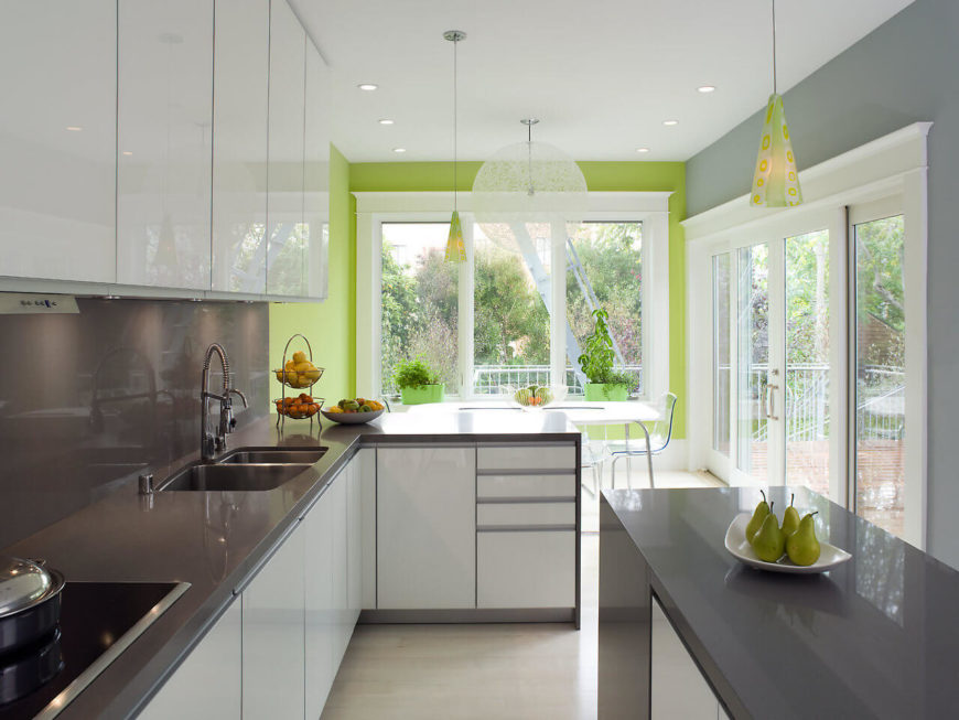 """In contrast to the """"old-meets-new"""" approach of the previous rooms, the kitchen boasts a sleek and angular feel. Selections of fruit act as both accessories and your next meal."""