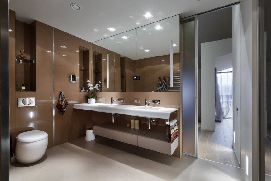 The primary bathroom is a giant leap from the second bathroom. With sleek taupe walls, the space is seamless and chic.