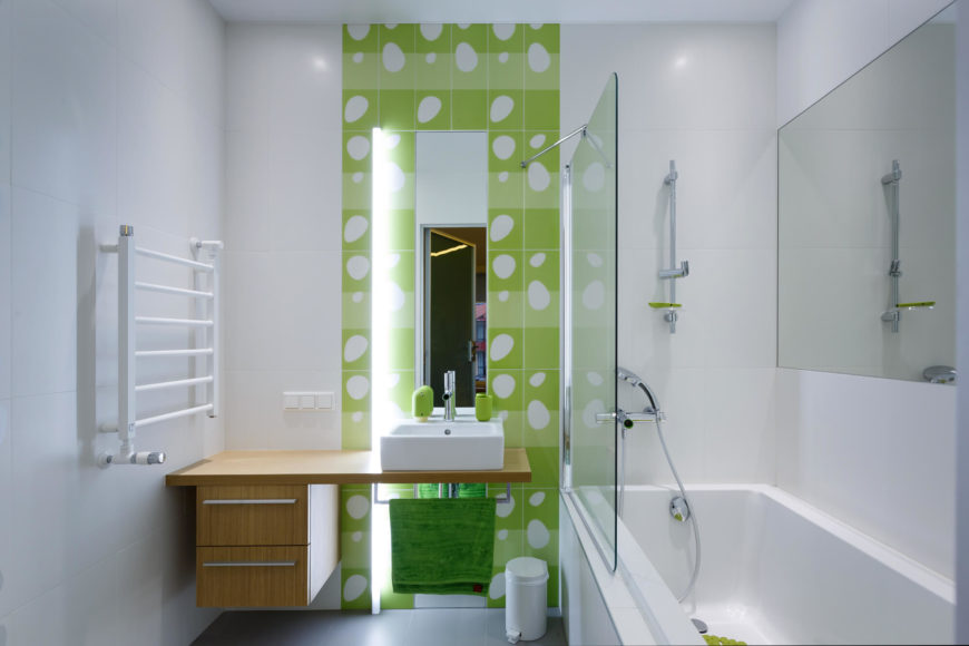 The downstairs bathroom matches the creativity and playful nature of the child's bedroom. With a lime green color scheme, and a low shower head, this bathroom accommodates a family-oriented household.