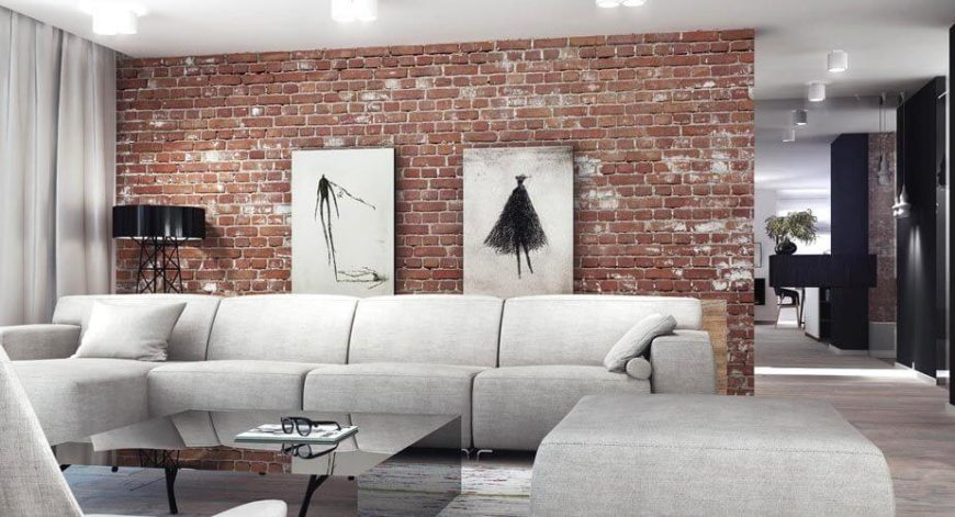 Family room with a brick accent wall.