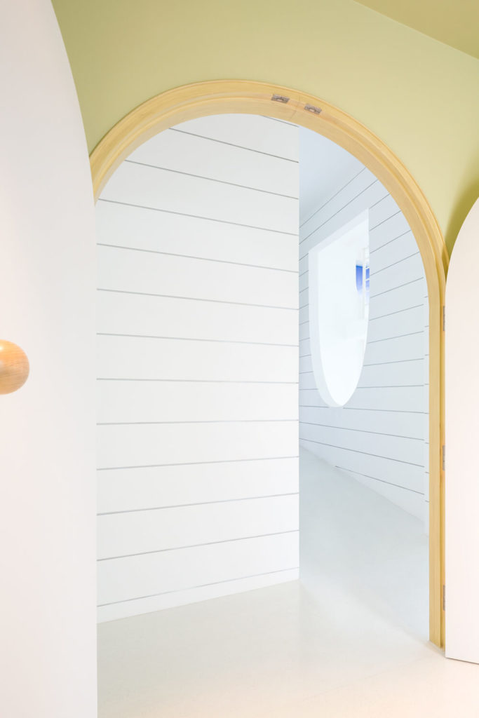 Even the standard doorways within the home project a sense of the whimsical, with arched tops and striking colors.
