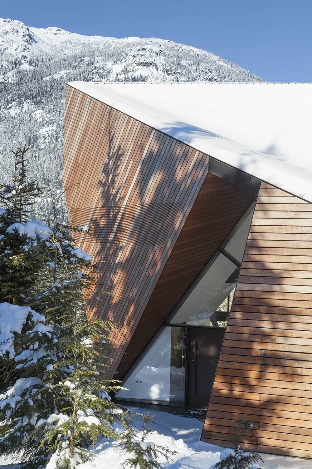 The home's entrance is hidden in a small nook and led up to by a small road connecting to the side street at the top of the valley.