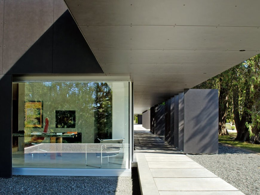 Here's a close look at the glazing that covers most of the actual home exterior, offering expansive views and sleekly modern style. The louvers, seen at right, create a buffer between the elements and the interior.