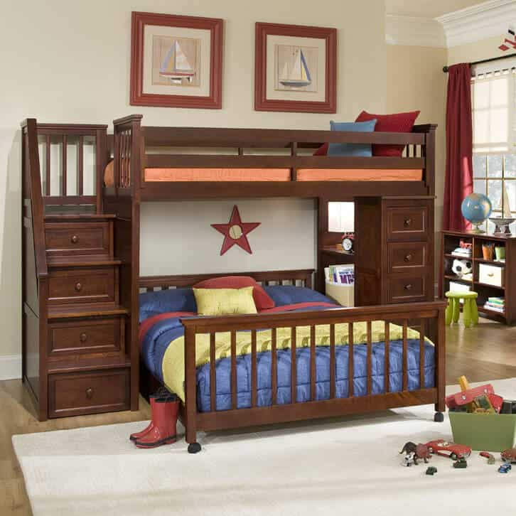 This immense dark stained wood frame bunk bed features the perpendicular lower bunk design, built on casters for easy movement. A full dresser set and shelving is built into the right side, while a staircase with drawers is built into the left.
