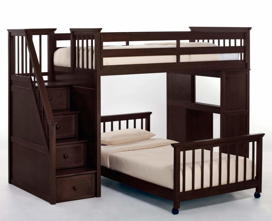 This stately bed frame in dark stained hardwood features a similarly elegant set of stairs with drawers built-in, wrapped with a traditional staircase railing. With a desk on the opposite side and detachable lower bed, it's a versatile piece of furniture.