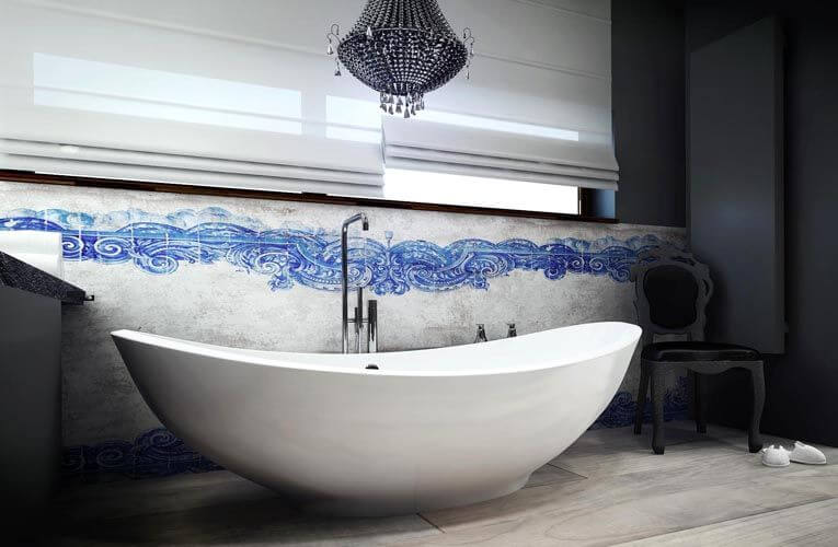 The sensual curvature of this bathtub, combined with the curve of the ornate wave mural along the backside of the wall and the black crystal chandelier makes for an elegant, soothing escape from the day's stresses.