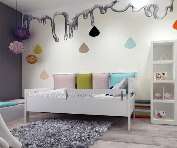 This colorful, yet somehow muted teenage girl's room has a custom mural on the wall behind the bed that resembles a melting cloud dropping colorful raindrops onto a rainbow border at the bottom of the wall. The daybed is in pristine white with a low bench against the darker wall.