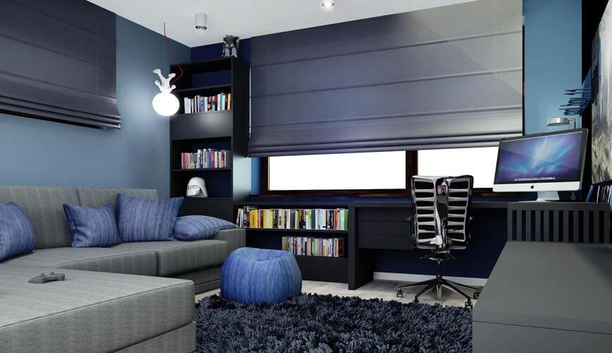 The media room is in shades of blue, black, and gray, with a long bookcase and desk combination along the wall. The small sectional faces a large television screen.