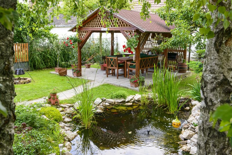 Peaceful garden with a little pond and a backyard pavilion to relax and entertain.