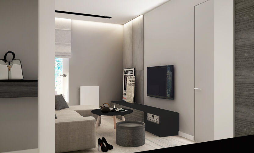 Viewed from the next room over, we see the sleek black media cabinet running low on the far wall, with the wall-mounted television above. Grey stained wood tones mix with the light natural hardwood flooring for a transitional palette.
