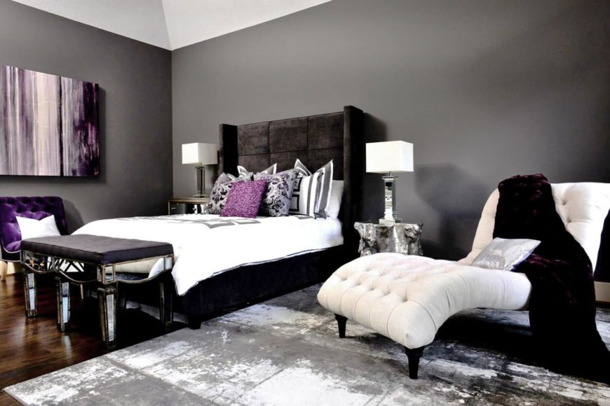 A glorious primary bedroom in royal purple, gray, and white.