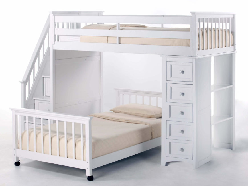 This bright white painted wood frame bunk bed features a movable lower bunk set perpendicularly below the frame. A full set of dresser drawers and open shelving on the right side are complemented by a set of stairs with built-in drawers on the left.