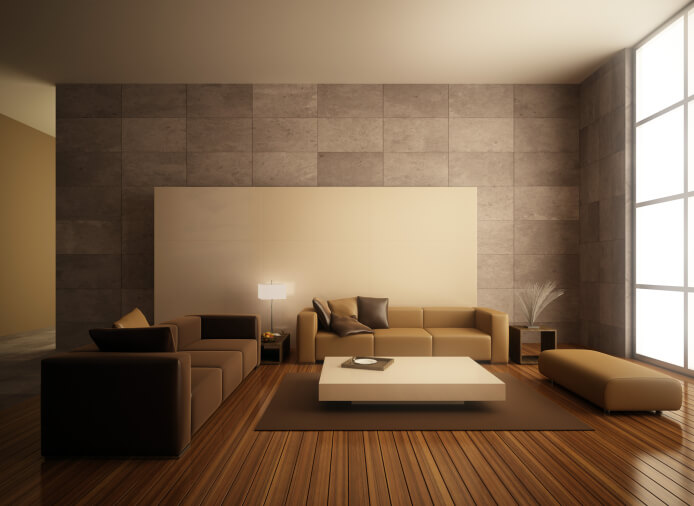 This minimalist modern living room space is brilliant in its simplicity. The perfect lines of the dark hardwood plank flooring complements the straight lines of the modern furniture perfectly. A large cream coffee table is mimicked by a sizable canvas behind the milk chocolate sofa, while the luxurious stone tile-work offers beauty and durability.