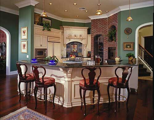 This kitchen is located in a quaint nook in the house. Being placed in the center of the home, it receives its gorgeous amber glow from several pendant lights.