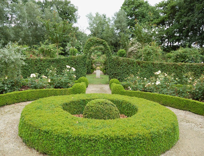 Repeating the round shapes throughout this garden helps keep a uniform theme despite the changes in direction and material.
