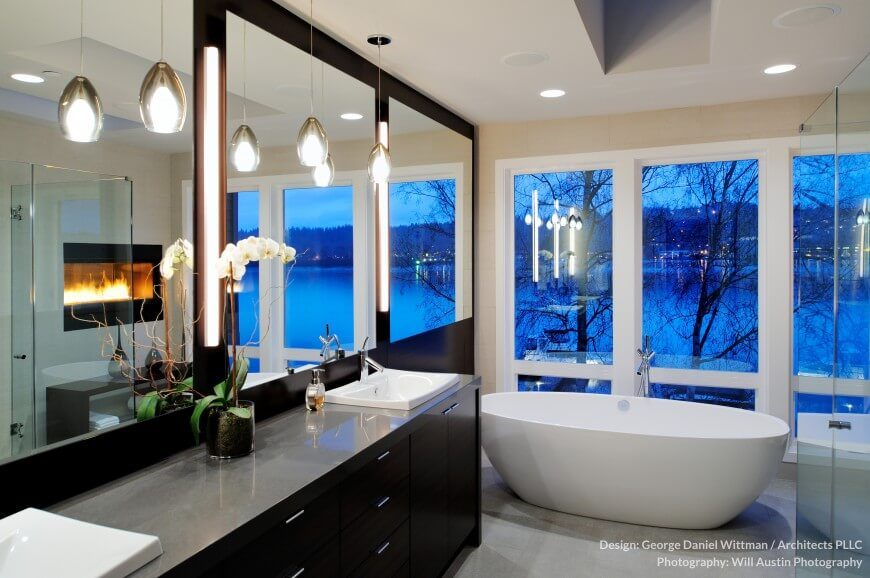 This charming bathroom has lots of windows for a fantastic and relaxing view. A fireplace built into the wall adds the perfect touch to make this room as peaceful as possible.
