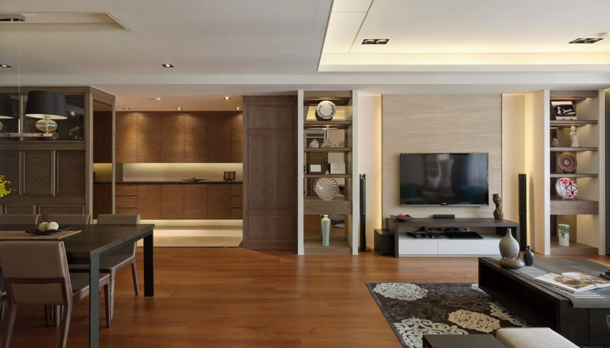 Here's a wide scope look at the largest open space in the home, with the wall details and furniture arrangements helping define the living and dining areas.
