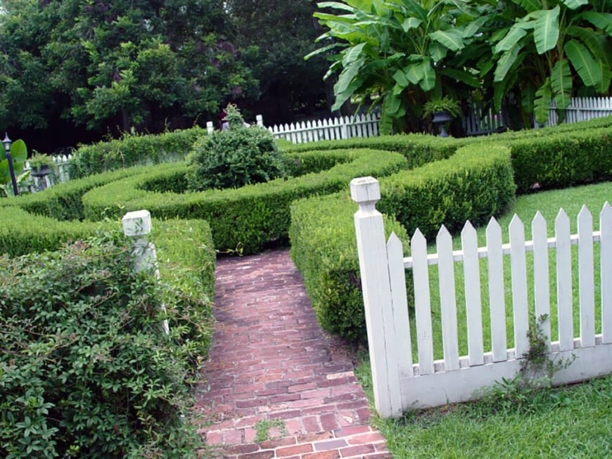 This beautiful space has a round hedge creating a small maze for multiple pathways. The hedges provide a beautiful walkway to three different destinations.