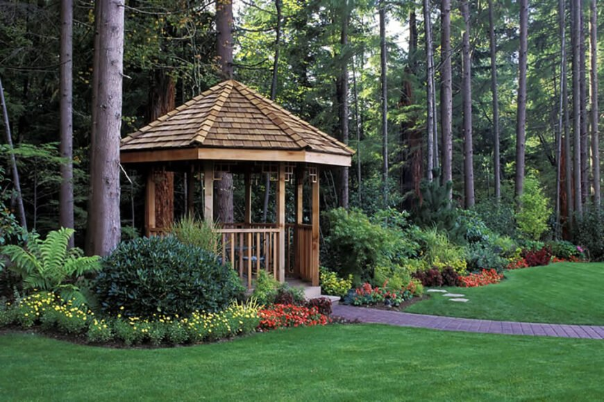 This cedar gazebo takes center stage in this lovely, lush garden.