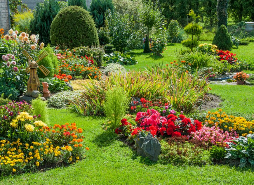 Looking out the window to see this bright riot of color and textures would make anyone happy. The winding path of grass amidst the flower beds gives this garden an even more whimsical touch.