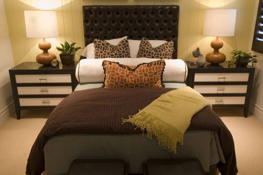 This headboard is not your regular upholstery. This beautiful space is paired with a rich dark leatherette headboard for that polished look.