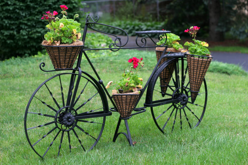 More decorative than using an antique bike, this wrought iron affair is an elegant touch to this lovely yard.
