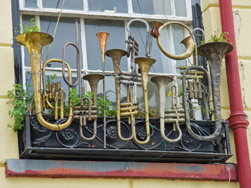 What to do with old, unusable instruments? Make planters out of them! Utilizing the bells of these horns to house plants is a creative decision.