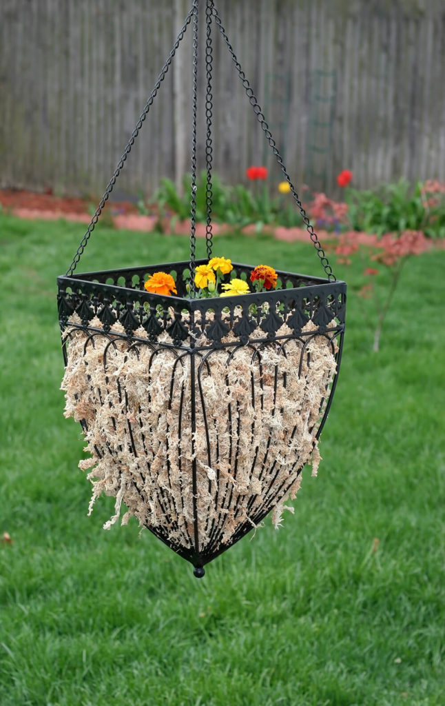 This elegant hanging planter would look great in any garden, hanging from the eaves of a house, or around a patio.