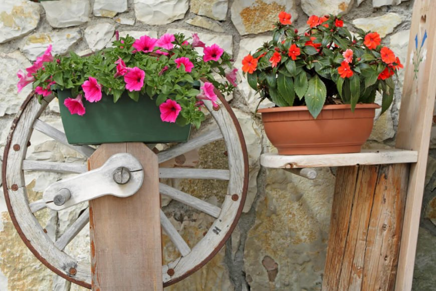 This is a lovely repurpose of this antique spinning wheel. Placing this in a garden surrounded by big leafy bushes and bright flowers would also be attractive.