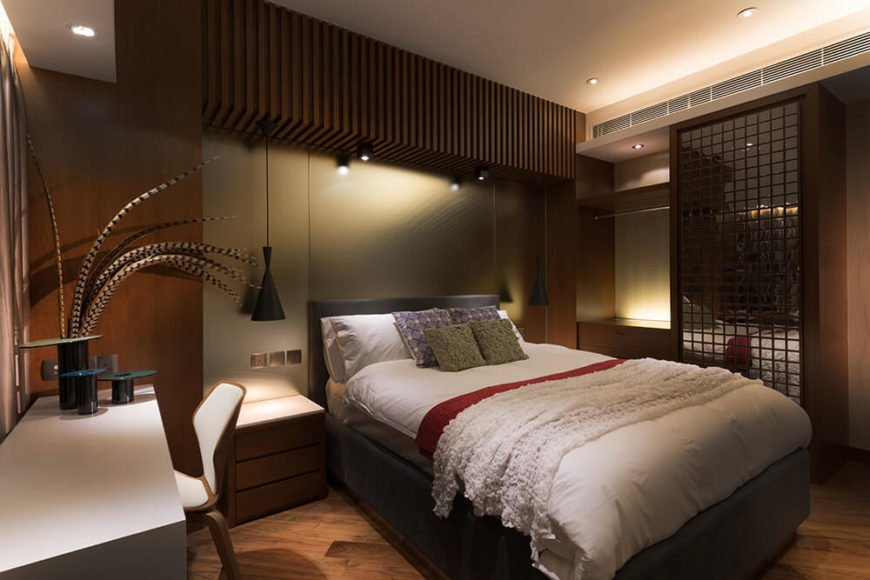 The first of two guests rooms follows the feeling invoked by the primary bedroom. The use of a metallic wall and the glass feature is meant to give the room the illusion of space.