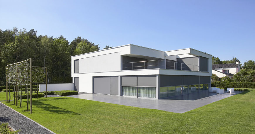 The starkly minimalist home conceals loads of intricate detail behind a simple white and grey facade.
