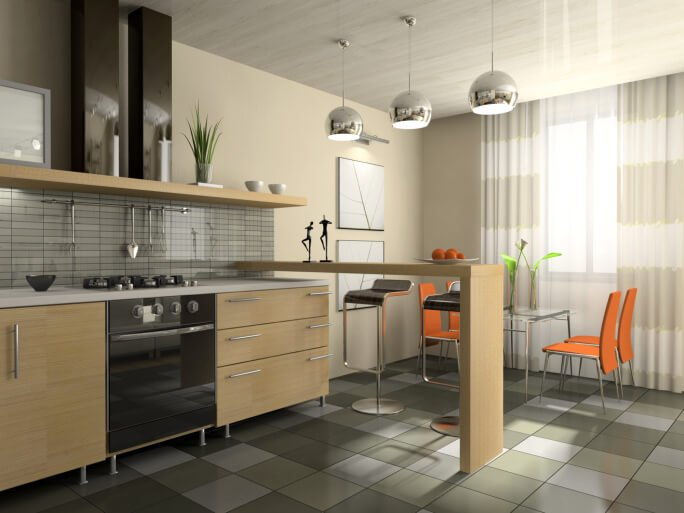 Black appliances, with natural light wood cabinets and an open dine-in bar, create a stunning contrast with other elements in the room, including the orange dining chairs and silver pendant lights.