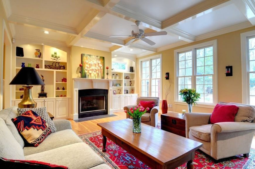 Blending this fan with the ceiling color allows for the white ceiling to offset the use of multiple bright colors in this fabulous room.