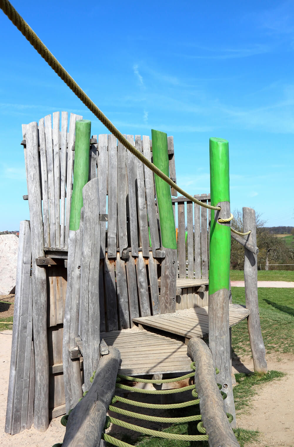 Rope bridges and balancing beams are another fun activity to add to a playset, as long as they aren't too far off the ground!