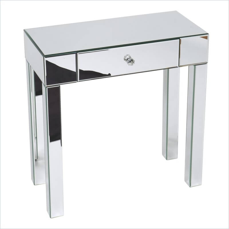 A mirrored table is perfect for bringing a touch of Hollywood Regency style to your home's foyer. A delicate glass knob is centered on the single drawer. This is a smaller piece that would look fantastic as a bedside table as well!