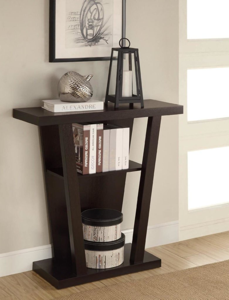 This dark wood table narrows as it reaches the floor, and consists of two inner shelves. This smaller piece is perfect for a foyer with minimal available space