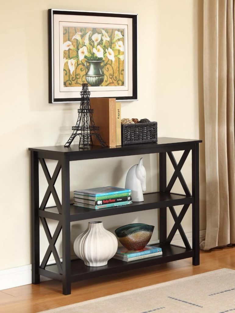 """The """"X"""" shaped details on the sides of this dark wood table add visual interest to an otherwise simple table with clean lines. Two shelves are perfect for storage baskets."""