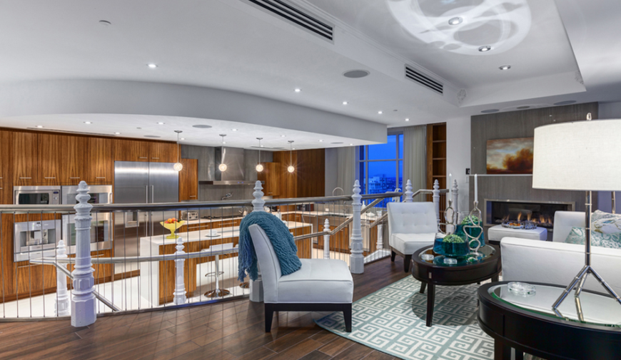 The gorgeous second floor living area of the Elysium penthouse boasts an open floor plan and beautiful woodwork.
