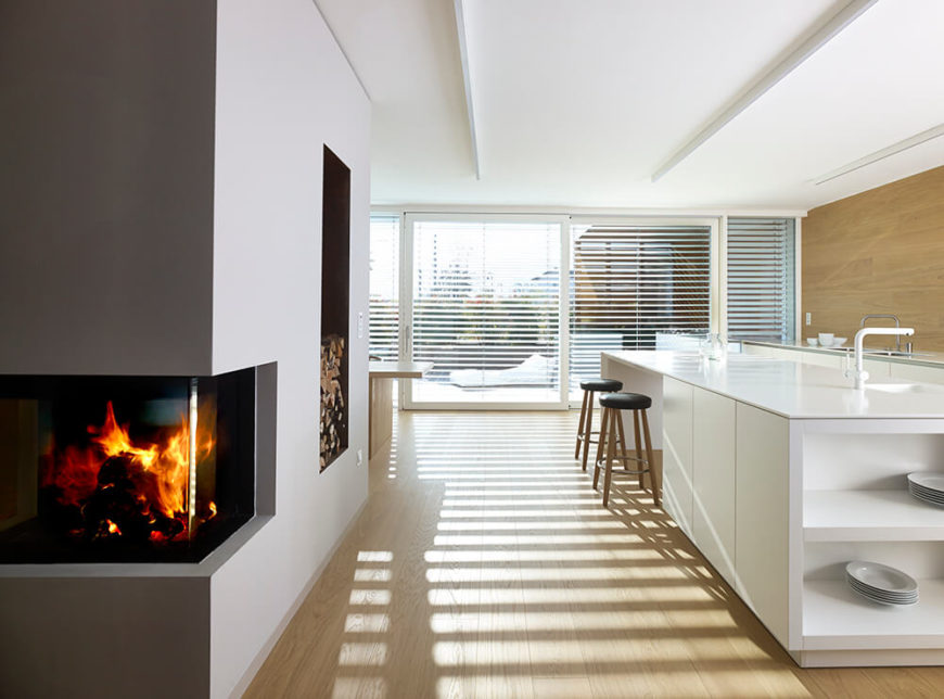 Moving back into the living room, we take a final look back at the kitchen from next to the roaring enclosed fireplace.