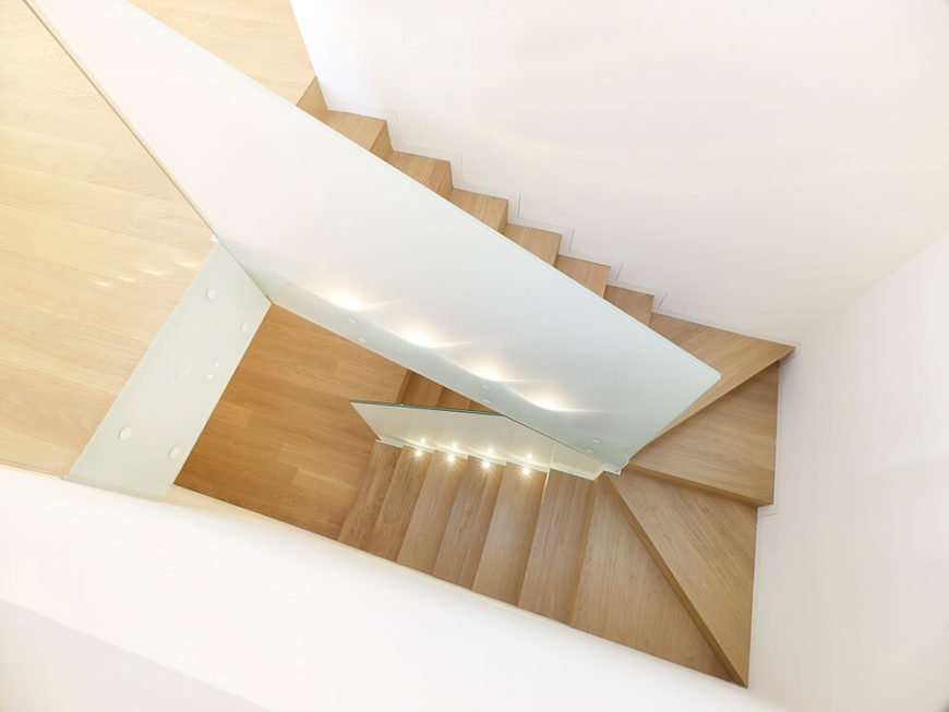 The view of the stairs from the attic, showing the sleek light wood design and lack of bannisters. The nature of the staircase ensures that it isn't going to take too much space.