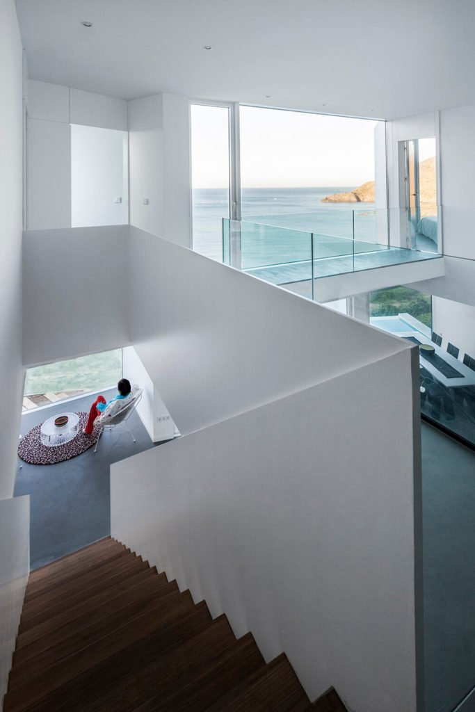 A glass-railing runs along the hallways above the two-story living room area, and into the bedrooms on the other side. Even the hallways have incredible views.