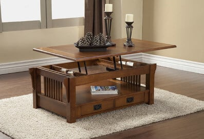Magazine racks are built into the sides, and drawers into the bottom. The top lifts up as well.