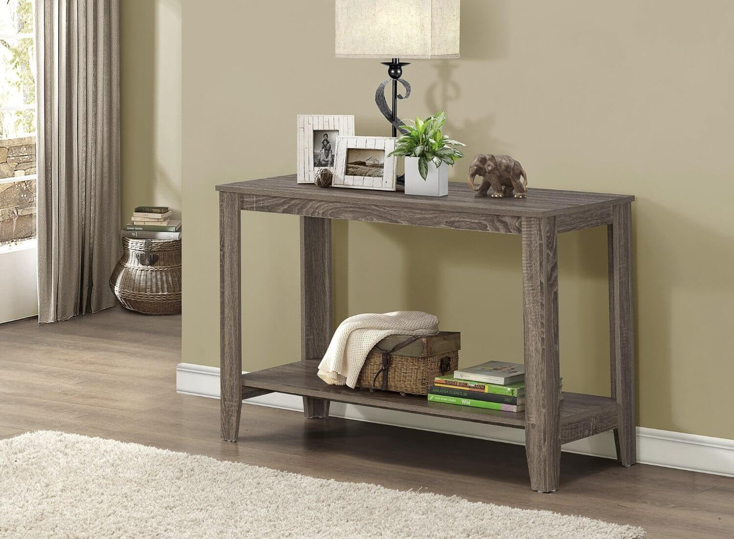 While the top of the table is used to house a lamp and several accents, the lower portion can house items in a basket.