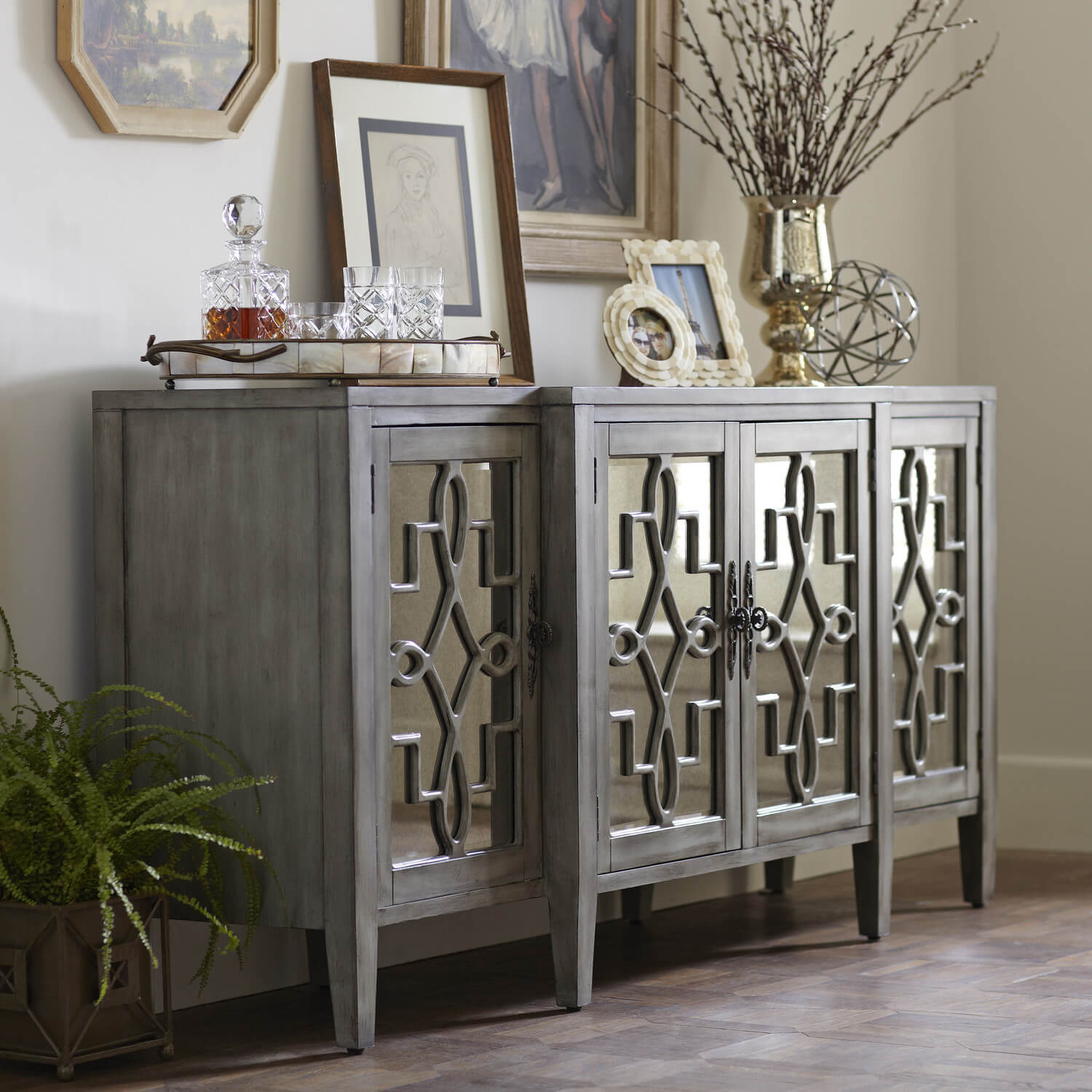 This credenza features a metallic front and an aged facade.
