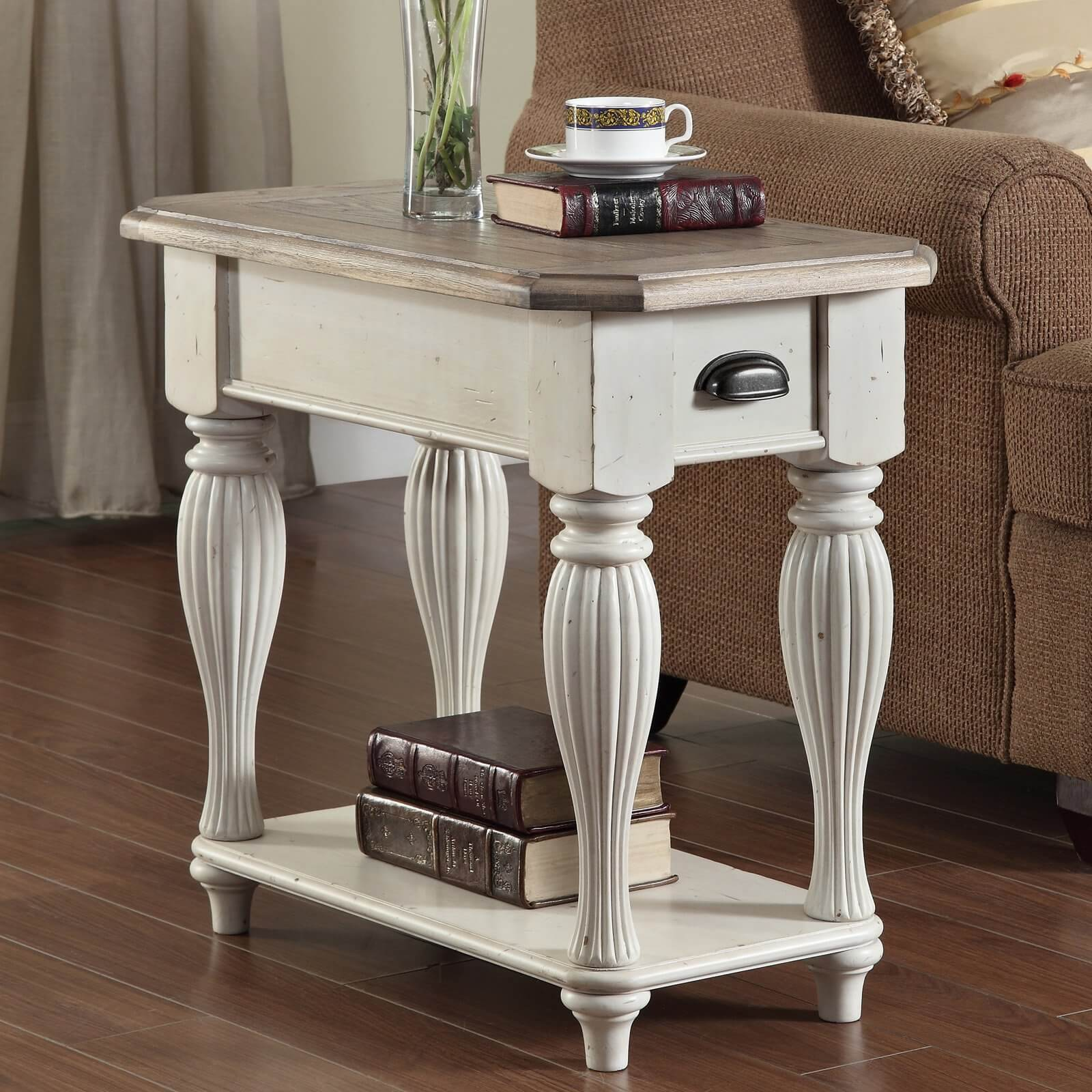 Elegant legs are connected by a single low shelf. A small drawer is above.