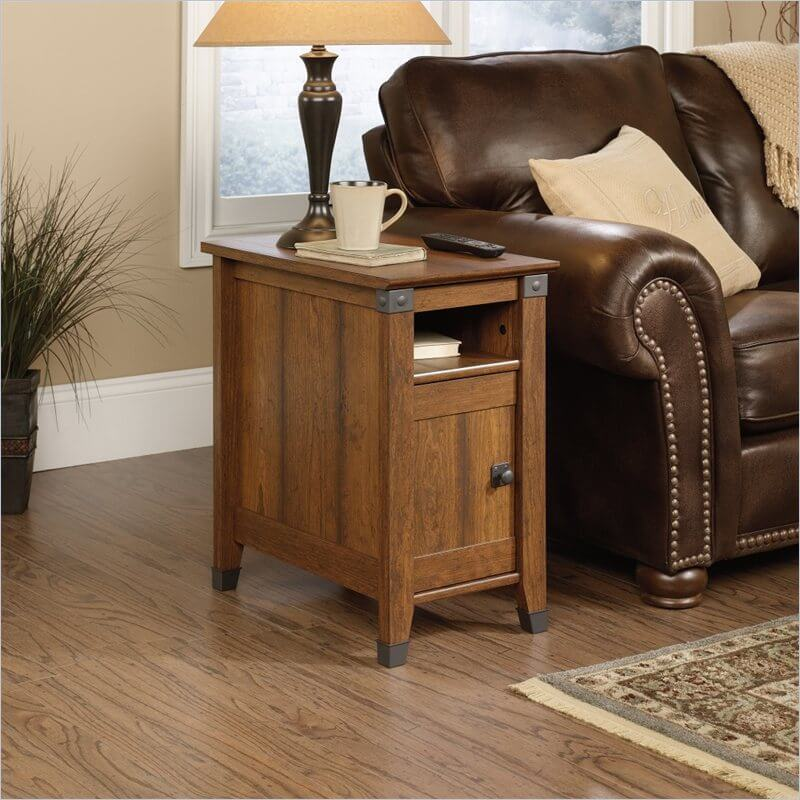 A small table with a cabinet below a shelf allows you to tuck away small clutter out of sight.
