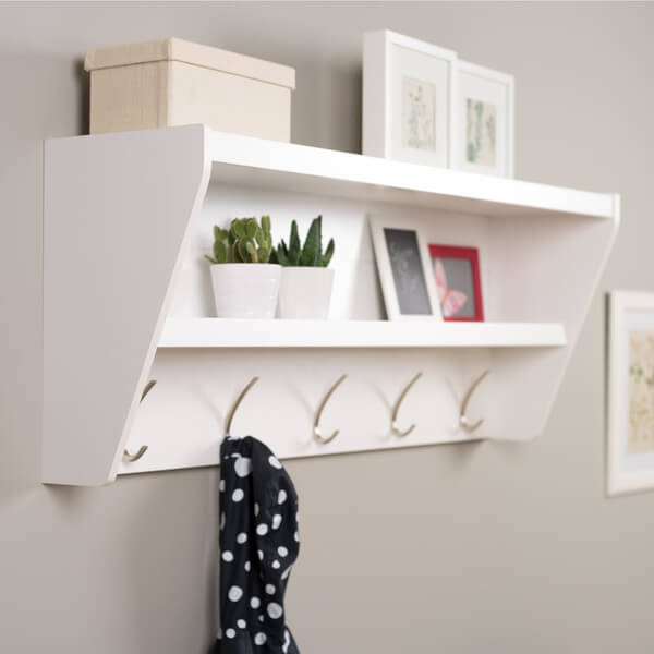 The above floating shelf is a great option because of the hooks in addition to the shelf. Add a few family photos or a decorative box to hold mittens or other small seasonal apparel.