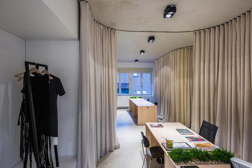 Here's another example of how the curtains can create highly distinct areas that may allow for better focus on a range of specialized work. This corner houses an elegant white display space.